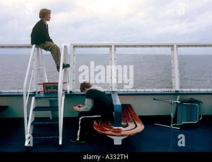 Two young boys on a ferry ship of the Reederei Color Line - Stock Photo