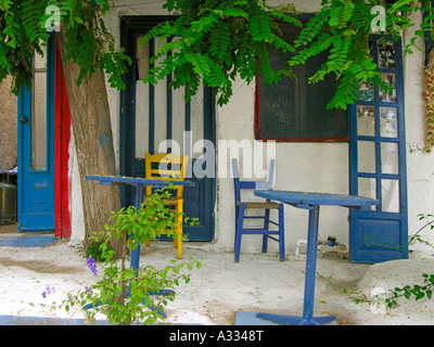 chairs in front of a typical Greek house in white and blue colours - Stock Photo