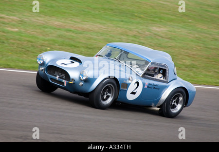 1962 AC Cobra during the Royal Automobile Club TT Celebration race at Goodwood Revial, Sussex. - Stock Photo