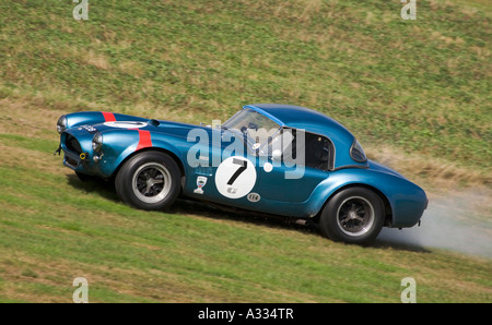1964 AC Cobra breaks down during the Royal Automobile Club TT Celebration race at Goodwood. - Stock Photo