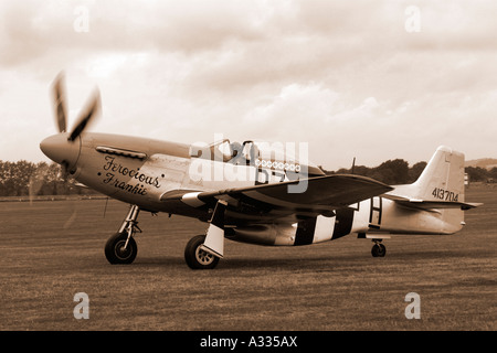 Mustang P51 'Ferocious Frankie', American single seater fighter plane of World War II taxis on grass runway. - Stock Photo