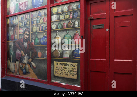 Penzance Cornwall Cornish England Humphry Davy mural in shop window Inventor miner's safety lamp - Stock Photo