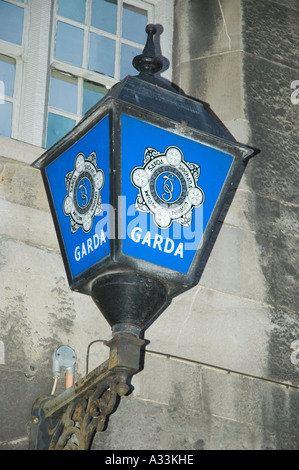Garda signs in a light outside a police station Dublin Ireland - Stock Photo