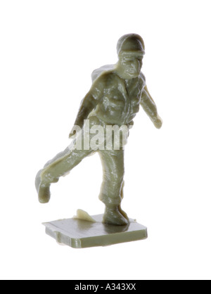 Miniature toy soldier running away - Stock Photo