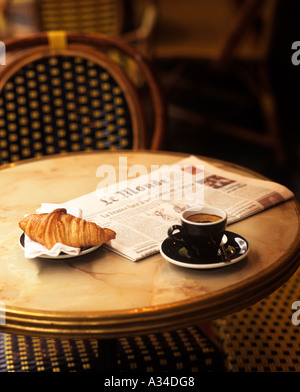 Coffee, croissant and newpaper in cafe , Paris , France - Stock Photo