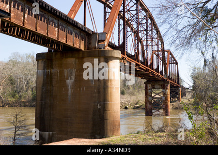Old rusty steel railroad bridge over the Flint River in Albany Georgia - Stock Photo