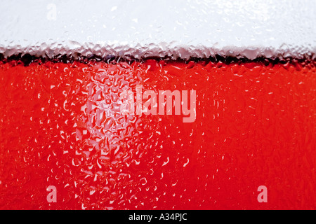 Extreme close up of side of glass with rose wine in it with chilled water droplets on the side - Stock Photo
