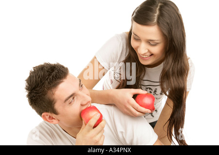 Young couple holding apples - Stock Photo