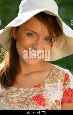 Young smiling woman wearing hat - Stock Photo