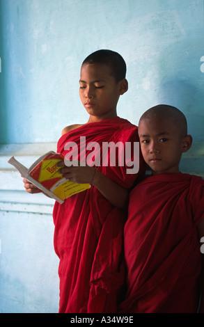 Novice monk studying at Shwezigon Paya Bagan Myanmar - Stock Photo
