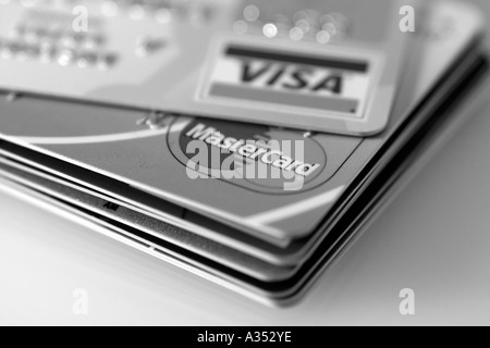 Black-and-white close-up of major credit cards. - Stock Photo