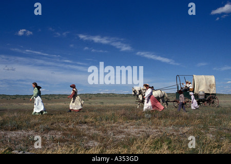 Pioneer family crosses prairie at the Little Bighorn Custer battle re enactment Crow Agency lands near Hardin Montana - Stock Photo