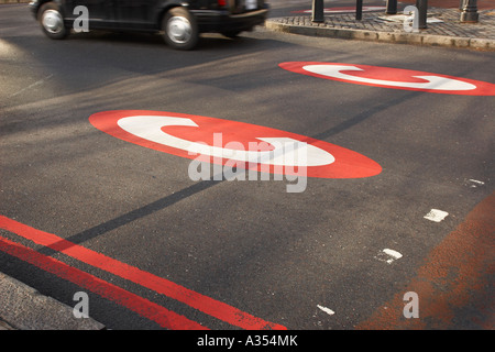 Congestion Charge sign on the road with a taxi  cab london - Stock Photo