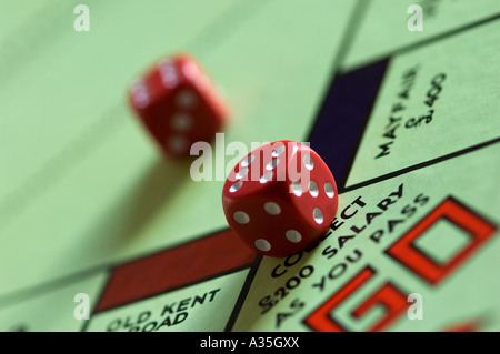 Close up of dice on monopoly board - Stock Photo