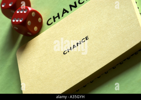 Dice and monopoly chance cards concept - Stock Photo