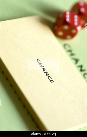 Close up of dice and monopoly chance cards - Stock Photo