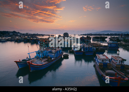 fishing boats in the harbour fleet at dawn Nha Trang Vietnam - Stock Photo