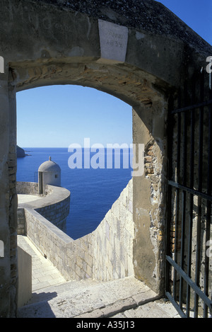 View of Turret and Old City Walls from stone Archway surrounding medieval town Dubrovnik Adriatic Sea Croatia Dalmatia - Stock Photo