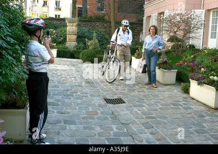 Paris France, Family in Charming Hotel in 'Latin Quarter' Tourists visiting Courtyard, Bicycle Helmets, Child - Stock Photo