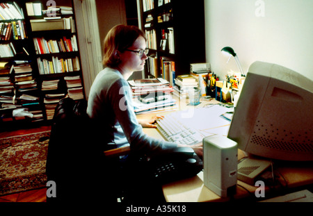 Paris, France, Young Adult Woman, Working Late on Computer in Home Office, Busy Desk - Stock Photo