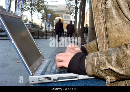 Paris FRANCE, Chinese Man Using WI Fi Internet, Detail, Hands Laptop Computer on Street - Stock Photo