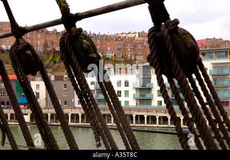 Modern and traditional housing viewed thru the rigging of the SS Great Britain - Stock Photo