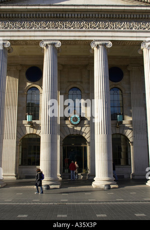 columns of the general post office GPO in o connell street the clock and window with people walking past dublin - Stock Photo