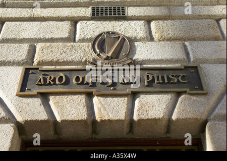 irish language sign ard oifig an poist and harp symbol above the door general post office GPO in o connell street - Stock Photo