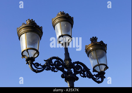 old gas street lamps now electric lights on bridge over the liffey in O Connell street Dublin - Stock Photo