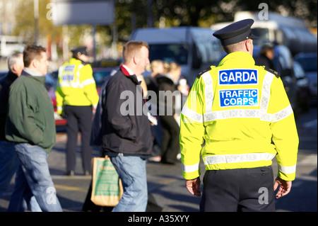 male garda siochana irish police force traffic police cop on traffic control duty on liffey bridge dublin - Stock Photo