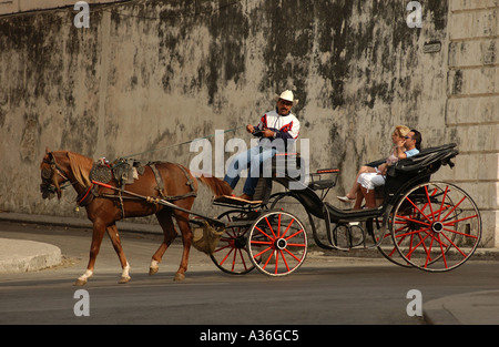 People in a horse carriage Havana Cuba - Stock Photo