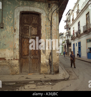 Person walking in an alleyway Havana Cuba - Stock Photo