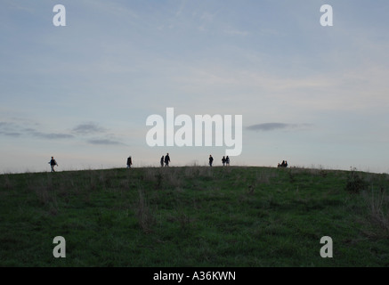 People walking along the top of Parliament hill, Hampstead Heath, London, UK. - Stock Photo
