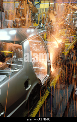 Spot welding robotics on assembly line at Saab plant in Sweden - Stock Photo