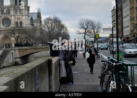 PARIS FRANCE NOTRE DAME CATHEDRAL AN EMBRACE ON THE LEFT BANK LATIN QUARTER - Stock Photo