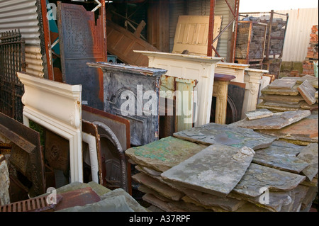 heritage architectural salvage yard with stone benches and plant