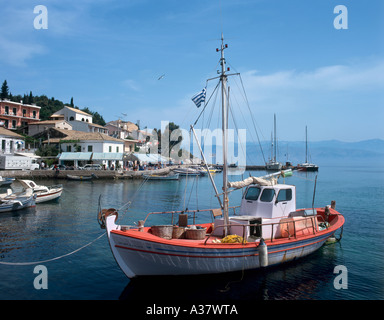 Traditional fishing boat in Kassiopi Harbour, North East Coast, Corfu (Kerkyra), Ionian Islands, Greece - Stock Photo