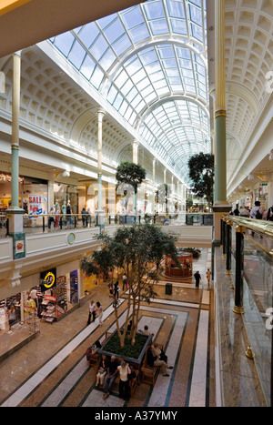 Interior of the Trafford Centre Shopping Mall, Manchester showing shops on two levels - Stock Photo