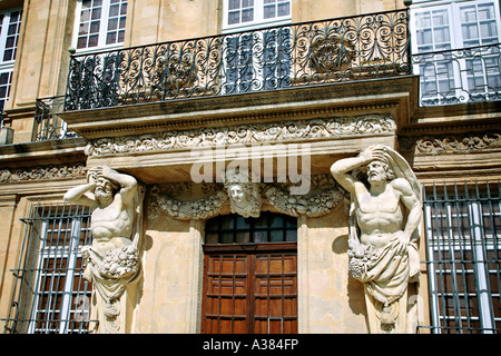 Pavillon Vendôme in Aix en Provence, France. Atlante, statue of a man supporting a construction. - Stock Photo
