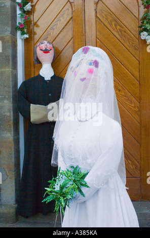 Paper machie The bride and groom waiting at the church Hinderwell festival. - Stock Photo