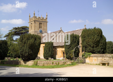 The Cotswold church of St Peter adjoining the manor house at Stanway, Gloucestershire - Stock Photo