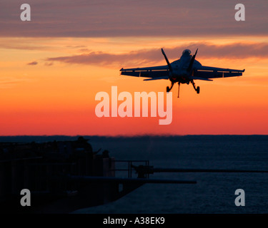 FA 18 Super Hornet launches off the flight deck of the aircraft - Stock Photo