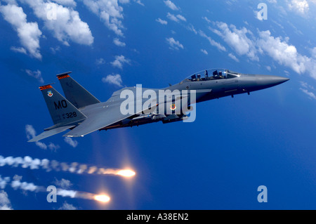 An Air Force F 15E Strike Eagle fires during training. - Stock Photo