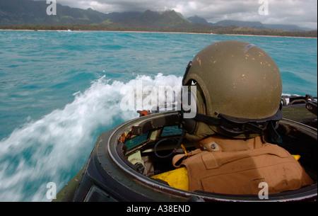USA marine driving amphibious assault vehicle towards beach - Stock Photo
