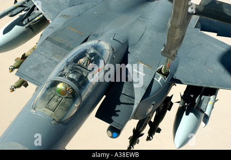 OVER IRAQ An F 15 Strike Eagle recieves fuel from a KC 10 during a combat mission  in support of Operation Iraqi - Stock Photo