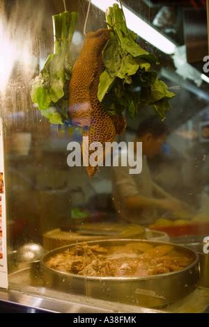 Preparing food in a Dai Pai Dong, Hong Kong - Stock Photo