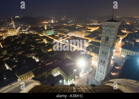 A wide angle view over Florence at night from the Duomo's public viewing platform showing Giotto's bell tower on - Stock Photo