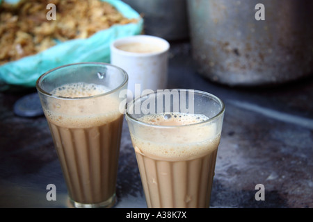 Chai made by a chai wallah in the spice market off Chandni Chowk, Old Delhi, India - Stock Photo
