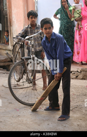 Boys playing cricket in a back street of Udaipur, Southern Rajasthan, India - Stock Photo