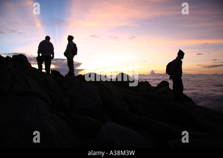 Hikers on the summit of Mt Kinabalu for sunrise, at 4095m the highest in SE Asia. Sabah, Borneo, Malaysia - Stock Photo